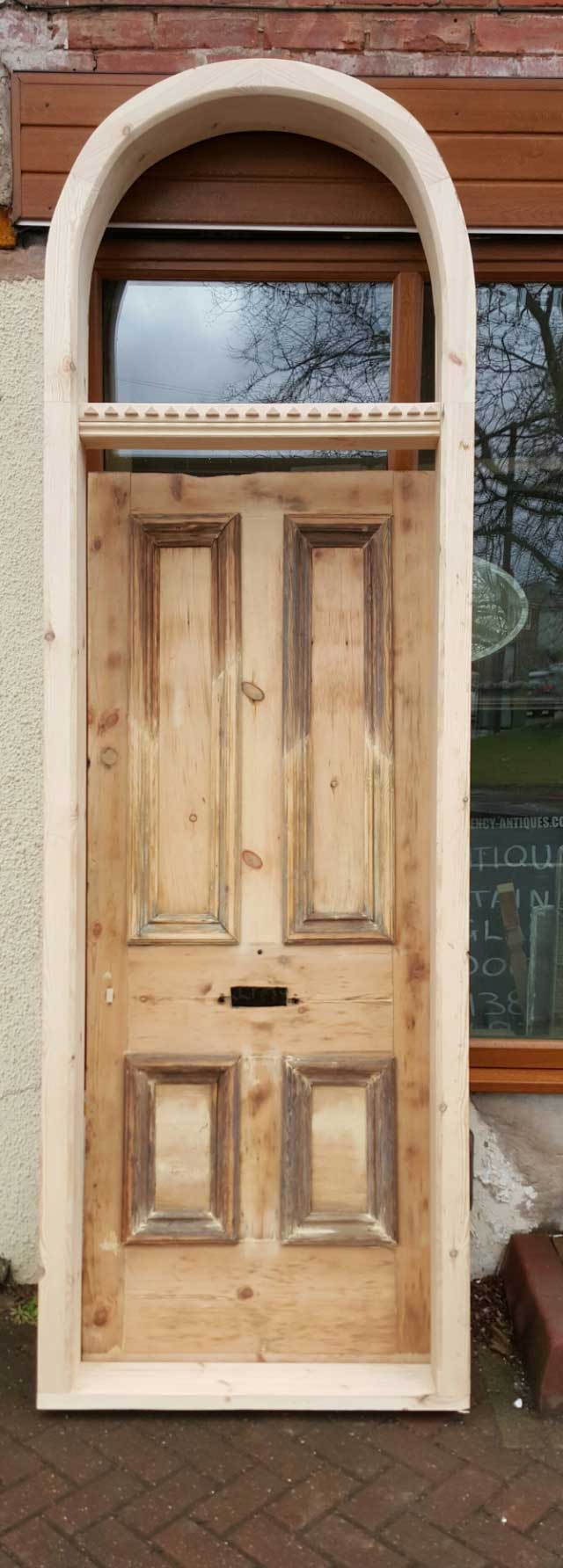 Grand Front Door With Elegant Frame Currently Available In The